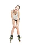 Young pretty woman on roller skates Royalty Free Stock Images