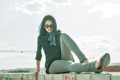 Young pretty woman on roof Royalty Free Stock Image