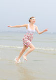 Young pretty woman running Royalty Free Stock Photography