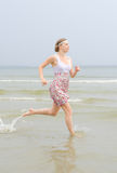 Young pretty woman running Royalty Free Stock Images
