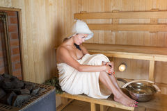 Young pretty woman in sauna Stock Image