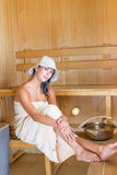 Young pretty woman in sauna Stock Photo