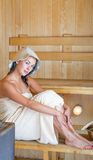 Young pretty woman in sauna Stock Images
