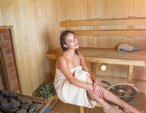 Young pretty woman in sauna Royalty Free Stock Photography