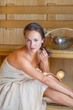 Young pretty woman in sauna Royalty Free Stock Images