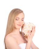 Young pretty woman with seashell, closeup female face portrait. Studio Royalty Free Stock Photos