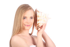 Young pretty woman with seashell, closeup female face portrait. Studio Royalty Free Stock Image