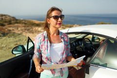 Young Pretty Woman See The Map Near The Cabriolet Royalty Free Stock Photos