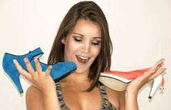 Young pretty woman with shoes Royalty Free Stock Images
