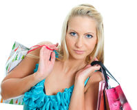 Young pretty woman with shop bags. Royalty Free Stock Photography