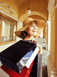 Young pretty woman shopping at european streets Royalty Free Stock Photos