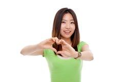 Young pretty woman showing heard shape. Stock Photos