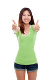 Young pretty woman showing thumb. Royalty Free Stock Photo