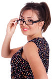 Young pretty woman in side pose looking at you Stock Photo