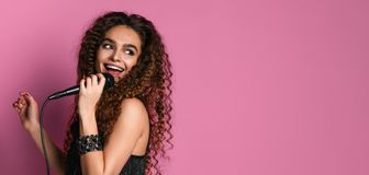 Young pretty woman singing in microphone isolated close up royalty free stock image