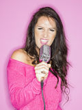 Young pretty woman singing Royalty Free Stock Photos