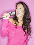 Young pretty woman singing Royalty Free Stock Photography