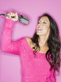 Young pretty woman singing Stock Photography