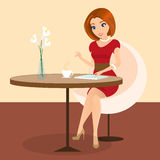 Young pretty woman sitting alone in the cafe and using a tablet pc Royalty Free Stock Photography