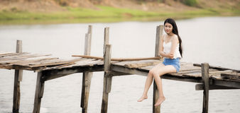 Young pretty woman sitting alone Stock Image
