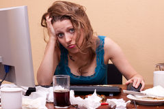 Young pretty woman sitting exhausted at work Stock Photos