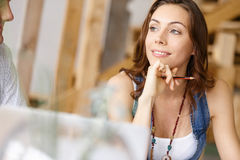 Young pretty woman sitting at her desk Royalty Free Stock Photos
