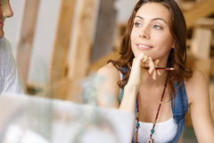 Young pretty woman sitting at her desk Royalty Free Stock Photography