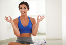 Young pretty woman sitting in lotus position Stock Image