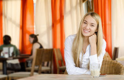 Young pretty woman sitting in restaurant Stock Photo