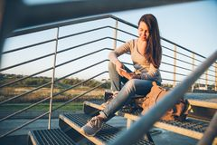 Young pretty woman sitting on the stairs of the mall Stock Photography
