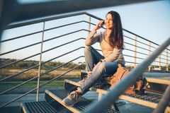 Young pretty woman sitting on the stairs of the mall Stock Photos
