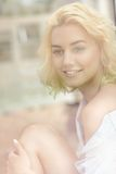 Young pretty woman sitting in the window in the morning Royalty Free Stock Photography