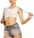 Young pretty woman with skipping rope isolated on Stock Images