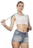 Young pretty woman with skipping rope isolated on Stock Photography