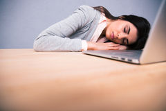 Young pretty woman sleeping on the table Royalty Free Stock Image