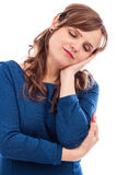 Young pretty woman sleeping, taking a nap Royalty Free Stock Photography