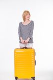 Young pretty woman smiling and holding travel case Royalty Free Stock Photos