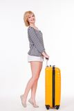 Young pretty woman smiling and holding travel case Royalty Free Stock Image
