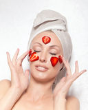 Young pretty woman with spa cosmetic pack. From strawberry Stock Photos
