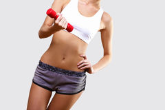 Young pretty woman in sport wear Royalty Free Stock Photos