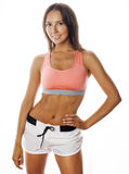 Young pretty woman in sports wear isolated on Stock Photography