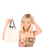 Young pretty woman standing with color-full shopping bags Stock Photography