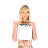 Young pretty woman standing with color-full shopping bags Royalty Free Stock Images