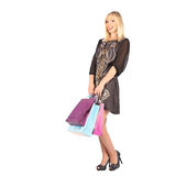 Young pretty woman standing with color-full shopping bags Stock Images