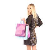 Young pretty woman standing with color-full shopping bags Stock Photo
