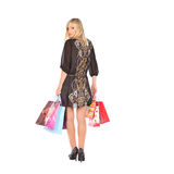 Young pretty woman standing with color-full shopping bags Royalty Free Stock Photography