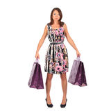 Young pretty woman standing with color-full shopping bags Royalty Free Stock Photos