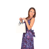 Young pretty woman standing with color-full shopping bags Stock Image