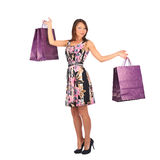 Young pretty woman standing with color-full shopping bags Stock Photos