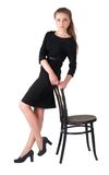 Attractive brunette woman holding on chair Royalty Free Stock Photos